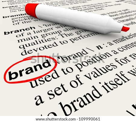 The word Brand defined in a dictionary with definition explained to emphasize awareness, branding, loyalty, identity and value