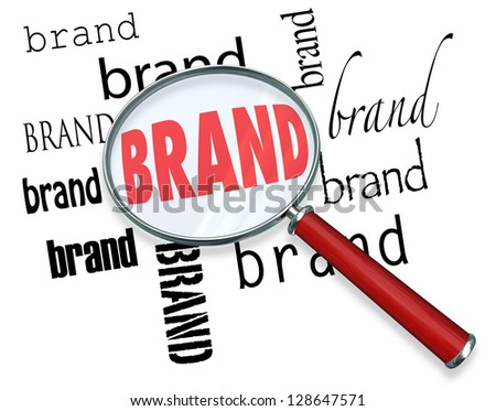 The word Brand under a magnifying glass illustrating marketing and advertising to build customer loyalty and reputation