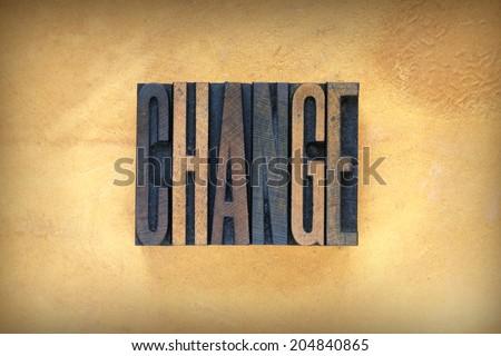 The word CHANGE written in vintage letterpress type
