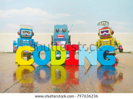 the word coding wit wooden letters on a old wooden floor with retro robot toys #797636236