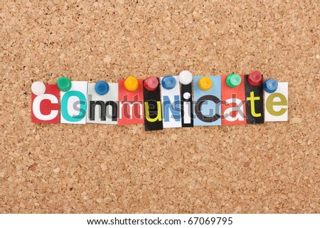 The word Communicate in cut out magazine letters pinned to a cork notice board