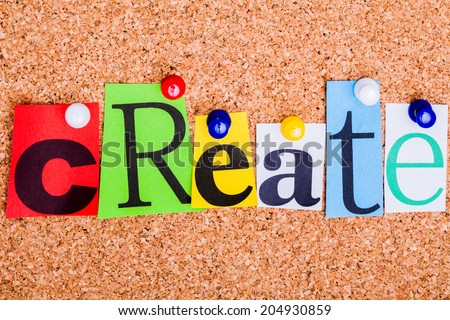 The word Create in cut out magazine letters pinned to a cork notice board.