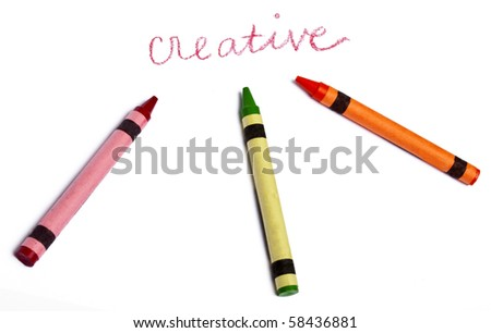 The Word Creative Handwritten with Several Vibrant colored Crayons on White.