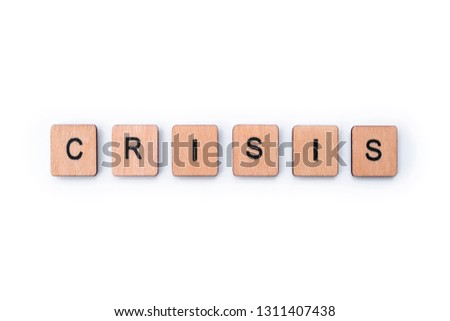 The word CRISIS, spelt with wooden letter tiles. #1311407438