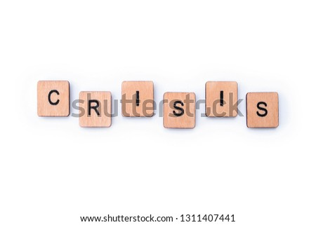 The word CRISIS, spelt with wooden letter tiles. #1311407441