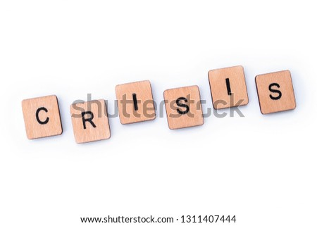 The word CRISIS, spelt with wooden letter tiles. #1311407444