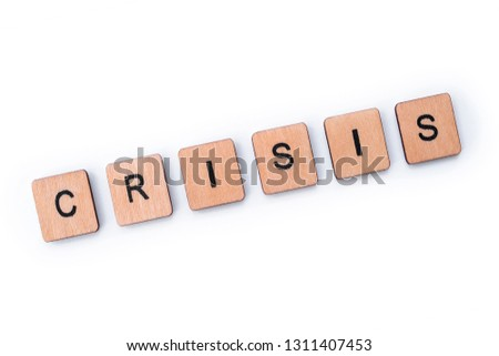 The word CRISIS, spelt with wooden letter tiles. #1311407453