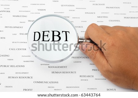 The word DEBT is magnified.