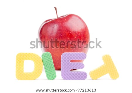 """The word """"diet"""" made ??of rubber children's letters and a little blurred red apple, isolated on white"""