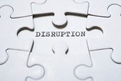 The word disruption written with a typewriter.
