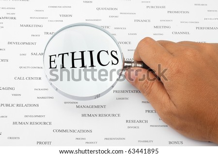 The word ETHICS is magnified.