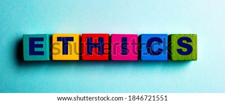 The word ETHICS is written on multicolored bright wooden cubes on a light blue background Stock photo ©