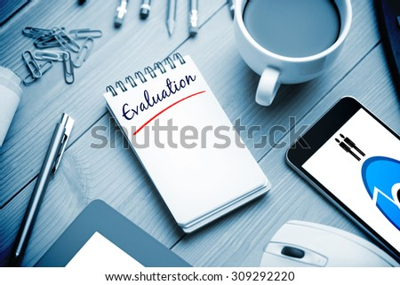 The word evaluation and coumpting against notepad on desk