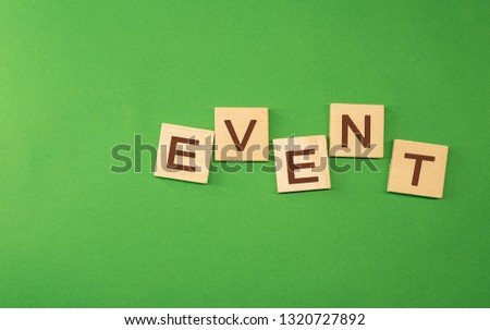 The word event written on wooden cubes green background #1320727892