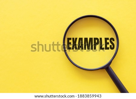 The word EXAMPLE is written on a magnifying glass on a yellow background. ストックフォト ©