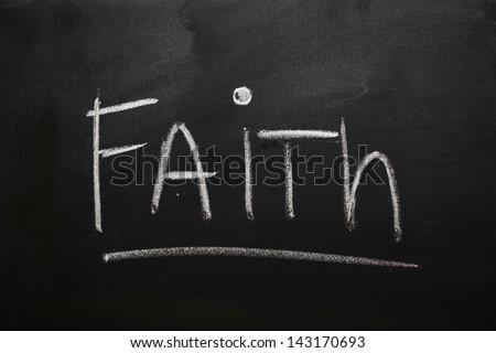 The word Faith handwritten on a blackboard - stock photo