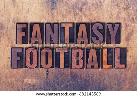 The word Fantasy Football concept and theme written in vintage wooden letterpress type on a grunge background. #682143589
