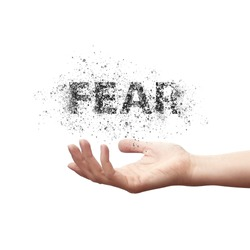 The word fear flies in a person's hand. Man dispels fears, people struggling with fear