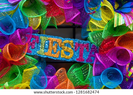 The word 'fiesta' written in colorful letters with glitter and mash #1281682474