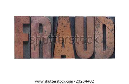 the word 'fraud' in old ink-stained wood type