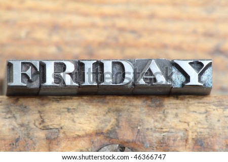 the word friday in letterpress type on a wooden background.