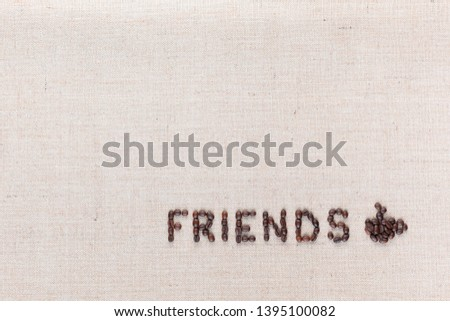 The word friends next to a hot coffee mug all made up from coffee beans ,aligned at the bottom left.