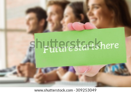 The word future starts here and hand showing card against smiling friends students talking and writing