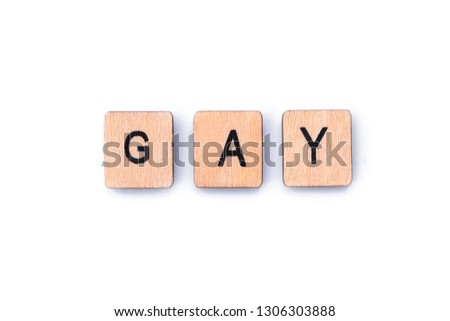 The word GAY, spelt out with wooden letter tiles. #1306303888