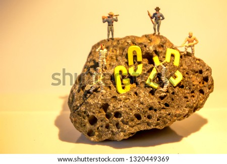 The word Gold on a rock surface to show the findings of any item really whether it be historic, treasure or for fun. #1320449369