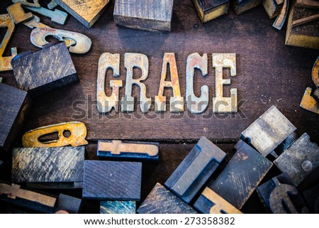 The word GRACE written in rusted metal letters surrounded by vintage wooden and metal letterpress type.