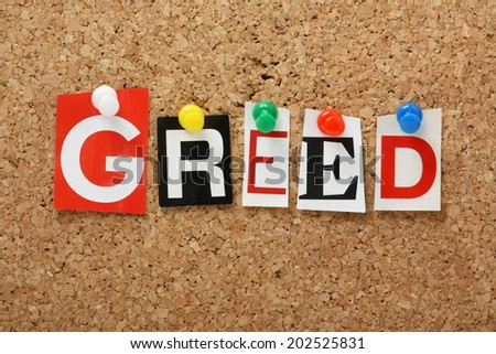 The word Greed one of the seven deadly sins in cut out magazine letters pinned to a cork notice board
