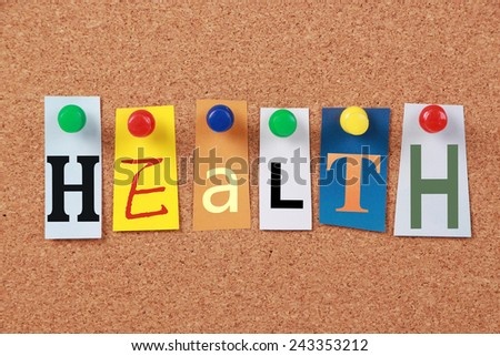 The word Health in cut out magazine letters pinned to a cork board.