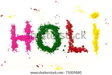 The word HOLI (the Indian festival of colors) spelled out with various colored dye powders.
