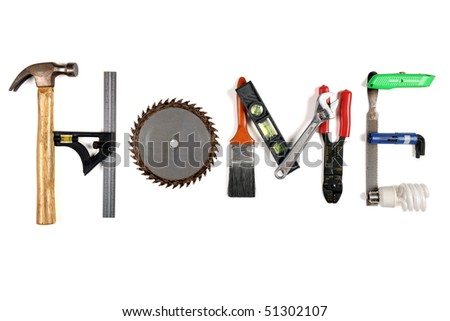 The word HOME made of tools over white background