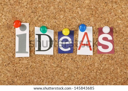 The word Ideas in cut out magazine letters pinned to a cork notice board. Ideas are the basis of creativity and success in business and life. - stock photo