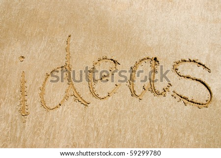 """The word 'ideas"""" written out in the sand"""