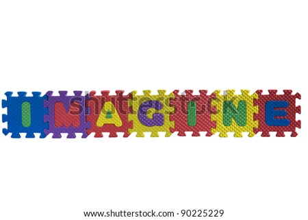 "The word ""Imagine"" written with alphabet puzzle letters isolated on white background"