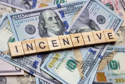 The word incentive on dollar usa background