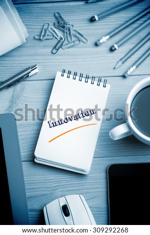 The word innovation against notepad on desk