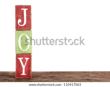 The word joy spelled out on blocks, isolated on white, Christmas ornaments.