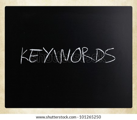 "The word ""Keywords"" handwritten with white chalk on a blackboard."