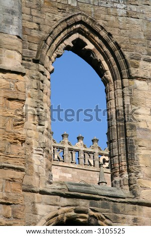 The word KING shown through an ancient abbey window - unusual use of the word in a historic setting