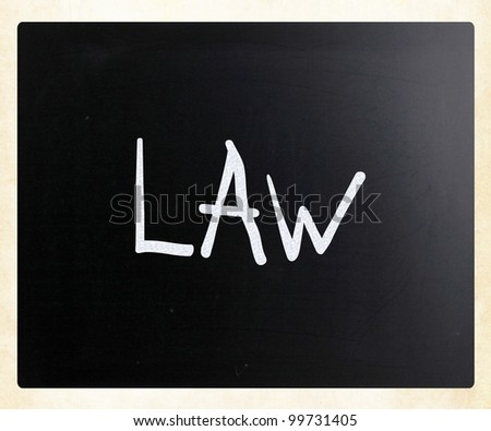 "The word ""Law"" handwritten with white chalk on a blackboard - stock photo"