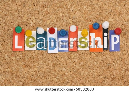 The word Leadership in cut out magazine letters pinned to a cork notice board