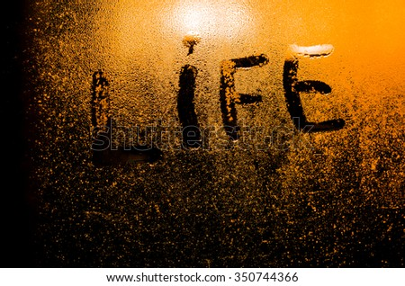"The word ""Life"" on the window in the rain, horizontal photo #350744366"