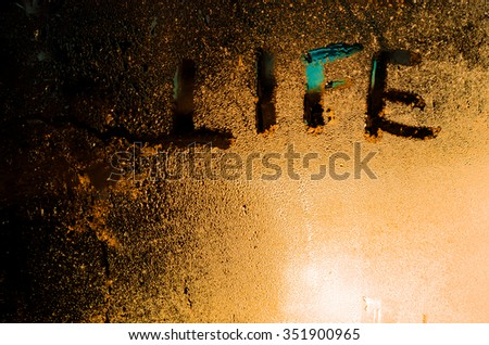 "The word ""Life"" on the window in the rain, horizontal photo #351900965"