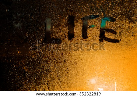 "The word ""Life"" on the window in the rain, horizontal photo #352322819"