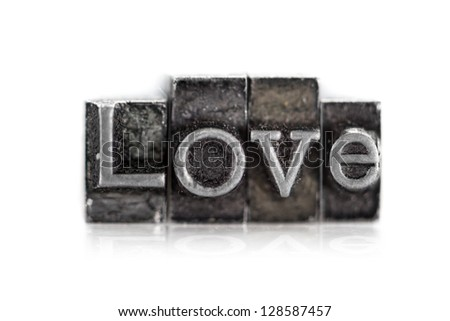"""The word """"love"""" in letterpress type on white background - Macro - stock photo"""