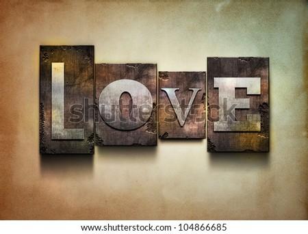 "The word ""Love"". Random letterpress type on grunge background."