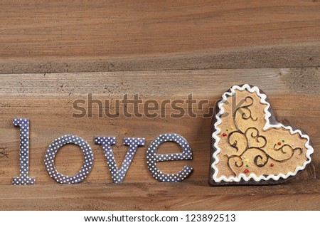 the word love with a heart cookie decorated - stock photo